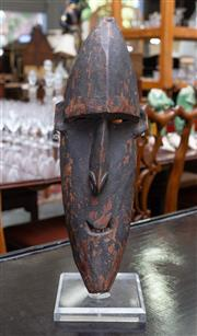 Sale 8746 - Lot 1050 - A tribal carved mask, possibly Pacific area, with articulated forehead & nostrils, on perspex stand