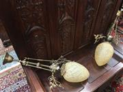 Sale 8882 - Lot 1079 - Pair of Art Nouveau Brass Hanging Lights, with turned post & supports with floral brackets, having mottled tear drop shaped shades