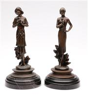Sale 9064 - Lot 26 - After Moreau Pair of Female Bronze Figures On Turned Marble Bases H: 27cm