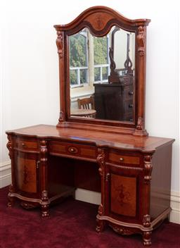 Sale 9190H - Lot 328 - A pedestal dressing table with bevelled mirror and three drawers and two doors with classial motifs, Height 195cm x Width 160cm x De...