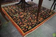 Sale 8335 - Lot 1049 - Probably Vintage Wool Gabbeh, with scattered animal & flower motifs on a black field (155 x 153cm)