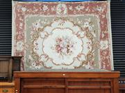 Sale 8868 - Lot 1058 - Large Aubusson Type Tapestry, with large floral spray & scroll frame, on a cream field and pink border