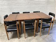 Sale 9092 - Lot 1085 - Teak extension dining table with 8 leather upholstered chairs (h:74 x w:190cm)