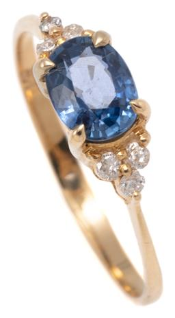 Sale 9149 - Lot 551 - A 9CT GOLD SAPPHIRE AND DIAMOND RING; centring an approx. 0.95ct blue oval cut sapphire to trefoil form shoulders each set with 3 ro...