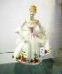 Sale 7346 - Lot 62 - A ROYAL DOULTON FIGURINE COUNTRY ROSE HN 3221