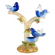 Sale 8000 - Lot 343 - A Murano glass sculpture of three bluebirds in gold aventurine branches with a nest.