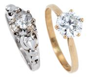 Sale 8915 - Lot 328 - TWO 9CT GOLD STONE SET RINGS; 1 in white gold set with an approx. 0.35ct round brilliant cut diamond (chipped girdle) size L1/2, oth...