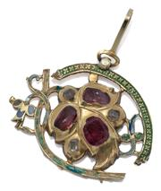 Sale 9046 - Lot 392 - AN ANTIQUE RUSSIAN ENAMELLED GOLD GEMSET PENDANT; leaf design with front foil back set with 3 rectangular rubies and 3 square and re...