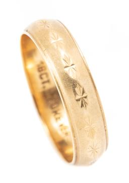 Sale 9182 - Lot 367 - A VINTAGE 18CT GOLD RING; a 4.7mm wide band with star engraving, stamped 18ct Forever, size O, wt. 3.94g.
