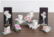 Sale 8486A - Lot 63 - Two Lladro floral mounted wedges together with a Continental three branch rose encrusted candelabrum and sundry related roses, damages