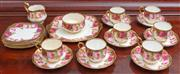 Sale 8595A - Lot 22 - A Royal Albert part tea set, with roses on a gold ground