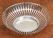 Sale 9071H - Lot 36 - An American silver pierced bon bon dish marked to base Gale Ford & co. Inc, diameter 18cm  weight 134.92g