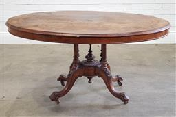 Sale 9215 - Lot 1041 - Victorian Burr Walnut Marquetry Loo Table, with oval top, raised on a turned bird-cage base, with outswept feet (h:75 l:134 w:98cm)