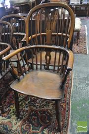 Sale 8335 - Lot 1070 - Assembled Set of Four Elm and Fruitwood Highback Windsor Chairs, with pierced splats & turned legs, some with crinoline stretchers