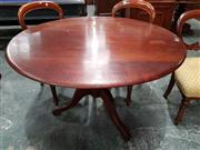Sale 8792 - Lot 1030 - Late 19th Century Cedar Supper Table, with circular top and turned pedestal base (H: 74 D: 116cm)