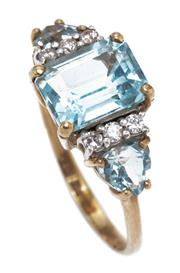 Sale 8915 - Lot 343 - A 9CT GOLD TOPAZ AND DIAMOND RING; centring an approx. 3ct emerald cut blue topaz between shoulders each set with a pear cut blue to...