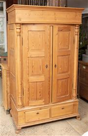 Sale 9060H - Lot 91 - A Continental pine two door bow front wardrobe with two panelled doors flanked by half columns over two drawers and carved feet. H 1...