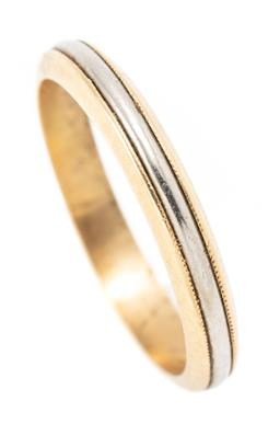 Sale 9182 - Lot 316 - A VINTAGE 18CT TWO TONE GOLD BAND; a 3mm wide, size O, wt. 3.29g.