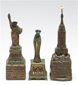 Sale 9253 - Lot 430 - Two metal money boxes (H:18.5cm - Statue of Liberty) together with a small religious sculpture