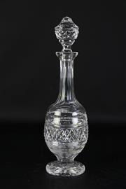 Sale 8923B - Lot 7 - A crystal decanter with starburst base and diamond cut banding and stopper. Height 38cm