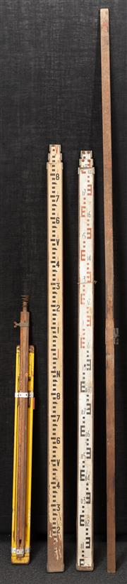 Sale 8984W - Lot 532 - Three Surveyors measures together with a smaller yellow example. Height of pair 193cm