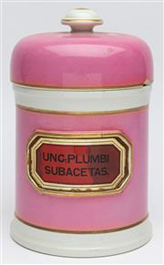 Sale 9054E - Lot 35 - A puce enamelled and gilt ceramic apothecary jar and lid bearing label Unc. Plumbi subacetas (Lead acetate) Height 22cm