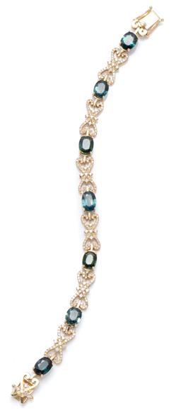 Sale 9123J - Lot 132 - A MULTI COLOURED DIAMOND TENNIS BRACELET; 3.5mm wide bracelet claw set with 7 round brilliant white, 30 round brilliant treated yell...