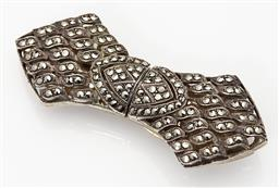 Sale 9123J - Lot 149 - Classic European Art Deco silver and marcasite brooch, C: 1940s which converts to a pair of dress clips. L: 60mm x 25mm