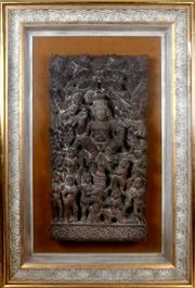 Sale 8000 - Lot 323 - A carved Hindu votive panel depicting a deity with smaller figures at his feet, possibly Balinese.