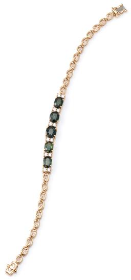 Sale 9124 - Lot 418 - A GREEN SAPPHIRE AND DIAMOND BRACELET; bead claw set in 9ct gold with 5 slightly graduated oval cut green sapphires totalling approx...