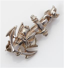 Sale 9123J - Lot 330 - An English hallmarked sterling silver Naval brooch, London 2004, in the form of a crown and fouled anchor with a small bird to the t...