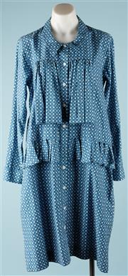 Sale 9090F - Lot 69 - A PETER JENSEN SMOCK SHIRT DRESS; having two side pockets and frills to the front, (appears to be cotton and medium to large size).