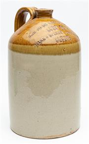 Sale 9054E - Lot 37 - A large earthenware bottle with handle, the shoulder impressed Jar to be returned to Luff Bros Wine & Spirit Merchants Clunes. Heig...
