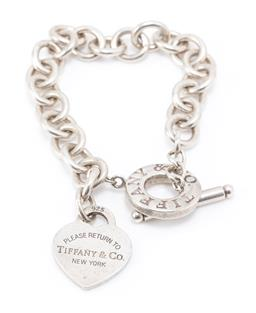 Sale 9177 - Lot 333 - A TIFFANY & CO SILVER HEART TOGGLE BRACELET; cable link chain to Please Return to Tiffany & Co New York heart charm and toggle cla...