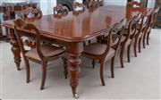 Sale 8595A - Lot 27 - A Victorian mahogany dining/banquet table, with four leaves, raised on five turned legs with porcelain castors, working on a winding...
