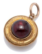 Sale 8999 - Lot 331 - AN ANTIQUE 15CT GOLD GARNET LOCKET; set with a round cabochon garnet to decorative engraved border with wire twist edge having a loc...
