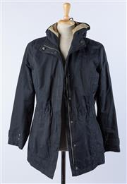 Sale 9003F - Lot 81 - A Navy Hooded Womens Cotton Jacket by Eddie Bauer (size L).