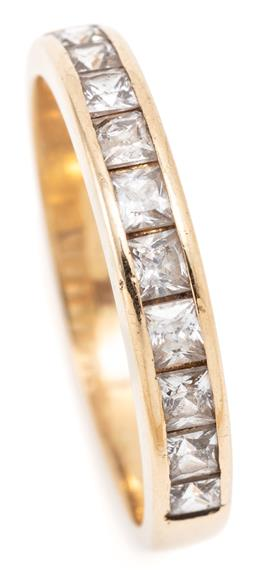 Sale 9128J - Lot 39 - AN 18CT GOLD STONE SET RING; 3.5mm wide band half hoop channel set with princess cut zirconias, size Q, wt. 3.30g.