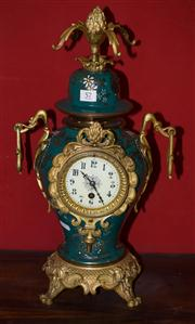 Sale 7962B - Lot 57 - C19th French Vase shaped Mantel clock highly decorated in enamel and bronze with floral motifs, key and pendulum.