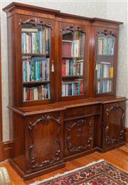 Sale 8649A - Lot 14 - A Victorian adapted mahogany break front bookcase, the later three glass panelled door top above a drawer and three carved panel doo...