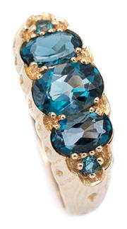 Sale 9083 - Lot 566 - A 9CT GOLD VICTORIAN STYLE TOPAZ RING; set with 3 graduated oval and 2 small round cut London blue topaz, size O, width 8mm, wt. 3.54g.