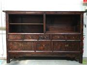 Sale 8649R - Lot 145 - Large Oriental Bookcase with Drawers and Sliding Doors (Repair to one shelf) (H:131 W: 203 D: 38cm)
