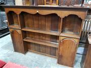 Sale 8962 - Lot 1057 - Georgian Style Oak Dresser Top, with shaped frieze, open shelves flanked by two arched top cupboards (base moulding needs re-attachi...