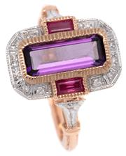 Sale 9090J - Lot 369 - A DECO STYLE 9CT GOLD GEMSTONE RING; millegrain set with a long emerald cut amethyst adjacent to 2 baguette cut rubies to surround a...