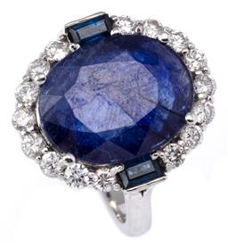 Sale 9123J - Lot 134 - AN 18CT WHITE GOLD SAPPHIRE AND DIAMOND RING; centring a blue oval cut sapphire of approx 5.ct surrounded by 16 round brilliant cut ...