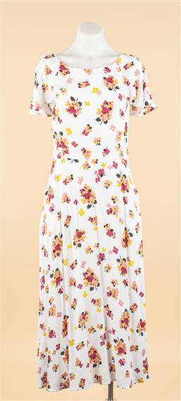 Sale 9250F - Lot 95 - An Emily & Fin short sleeved floral dress on white ground, with pockets, zip to back, size S (some markings and minor hole)
