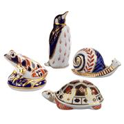 Sale 8000 - Lot 118 - A group of four Royal Crown Derby Imari pattern paperweights including a snail, frog, tortoise and a penguin.