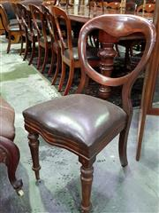 Sale 8653 - Lot 1080 - Assembled Set of 16 Victorian Mahogany Balloon Back Dining Chairs, with drop-in brown leather seats & on turned legs