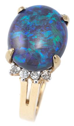 Sale 9124 - Lot 508 - A 14CT GOLD OPAL AND DIAMOND RING; featuring an oval cabochon solid black opal (cracks), size 13.95 x 11.66mm, with mostly blue and...