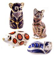 Sale 8000 - Lot 120 - A group of four Royal Crown Derby Imari pattern paperweights including a cat, koala, pine marten, and a pig.